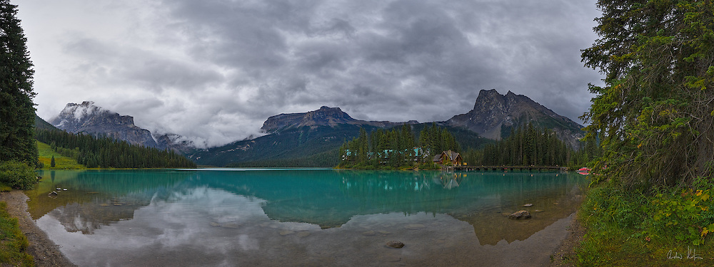A panoramic view of Emerald Lake from the west shore looking to the east.  Emerald Lake Lodge, Michael Peak, Wapta Mountain and Mount Burgess are visible in the distance.