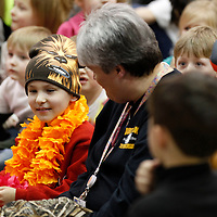 Thomas Wells | BUY AT PHOTOS.DJOURNAL.COM<br /> Brodey Houpt, left, takes his seat next to his teacher Angela Bates following the announcement that his wish was being granted for he and his family to go to Hawaii.