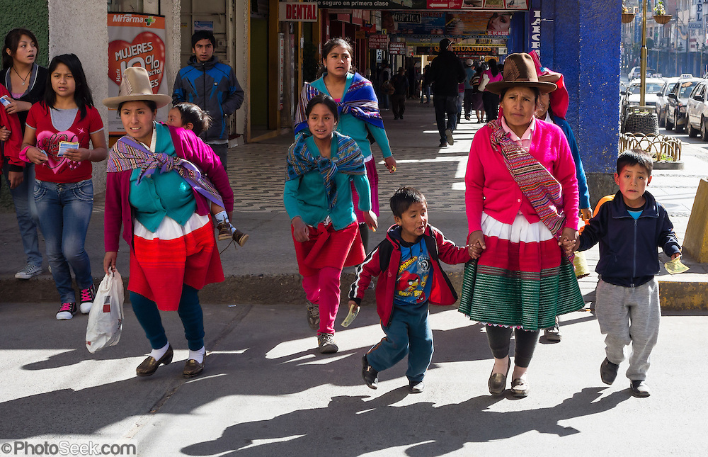 A campesino family shops in Huaraz, Callejon de Huaylas Valley, Ancash Region, Peru, Andes Mountains, South America.