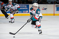 KELOWNA, CANADA - MARCH 22: Riley Stadel #3 of the Kelowna Rockets skates with the puck against the Kelowna Rockets on March 22, 2014 during game 1 of the first round of WHL Playoffs at Prospera Place in Kelowna, British Columbia, Canada.   (Photo by Marissa Baecker/Getty Images)  *** Local Caption *** Riley Stadel;