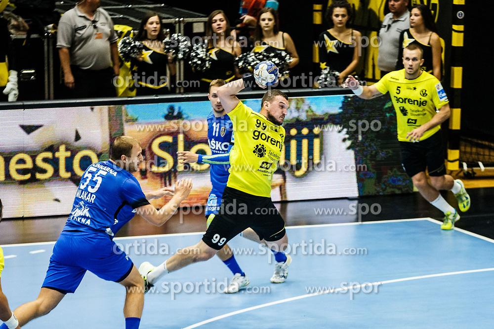 Pejovic Zarko #99 of RK Gorenje Velenje and Mlakar Ziga #55 of RK Celje Pivovarna Lasko and Marguc Gal #11 of RK Celje Pivovarna Lasko during handball match between RK Gorenje Velenje and RK Celje Pivovarna Lasko in SEHA league, Round 1, on 30th of August , 2017 in Rdeca Dvorana, Velenje, Slovenia. Photo by Grega Valancic/ Sportida