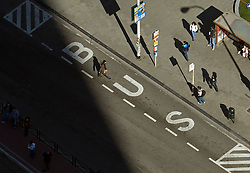 BRUSSELS, BELGIUM - APRIL-04-2007 - Aerial view of a pedestrian crossing the street at a bus stop in Brussels. (Photo © Jock Fistick)