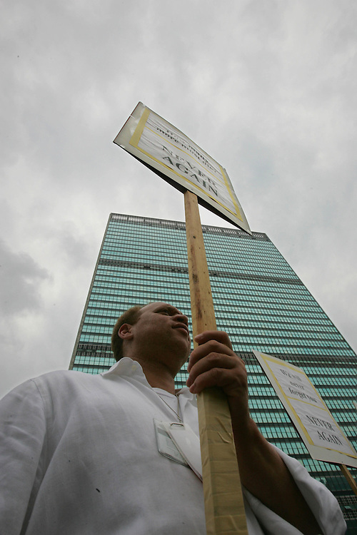 United Nations staff member Walter Pinn participate in a Silent March during a memorial for the victims of the bombing one year afo of UN Headquarters in Baghdad, Iraq Thursday 19 August 2004. U.N. officials in New York, Geneva and Amman, Jordan, held simultaneous observances recalling the bombing of the UN Headquarters in Baghdad on 19 August 2003 that brought a fundamental shift in U.N. operations. EPA/ANDREW GOMBERT