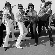 Elvis Presley impersonators ham it up during Tribute Week at Graceland in Memphis, Tennessee.
