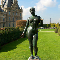 A statue in the Tuileries with the Eiffel Tower in background.