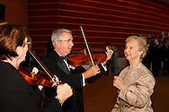 Retired Dayton Philharmonic Orchestra vilolinist Mary Arnett (right) gives a quick lesson in the instrument petting zoo to Peg & Dominick Rinaldi of West Carrollton during the Dayton Performing Arts Alliance Inaugural Gala at the Schuster Center in downtown Dayton, Saturday, October 5, 2013.