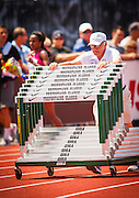 A volunteer wheels out hurdles during the second day of the Diamond League event Prefontaine Classic held at the University of Oregons Hayward Field.The Prefontaine Classic is named for University of Oregon track legend Steve Prefontaine.