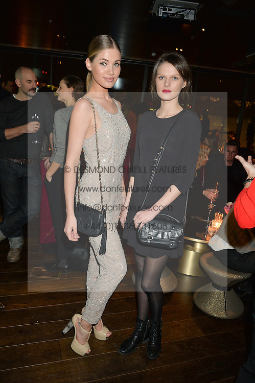 Left to right, KOTRYNA KOZLOVAITE and GRETA RIMS at the Launch Of Osman Yousefzada's 'The Collective' 4th edition with special guest collaborator Poppy Delevingne held in the Rumpus Room at The Mondrian Hotel, 19 Upper Ground, London SE1 on 24th November 2014, sponsored by Storm models and Beluga vodka.