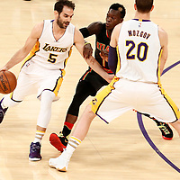 27 November 2016: Los Angeles Lakers guard Jose Calderon (5) drives past Atlanta Hawks guard Dennis Schroder (17) on a screen set by Los Angeles Lakers center Timofey Mozgov (20) during the Los Angeles Lakers 109-94 victory over the Atlanta Hawks, at the Staples Center, Los Angeles, California, USA.