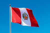 Peruvian Flag in the peruvian Andes at Puno Peru