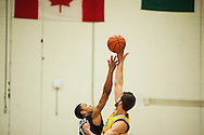 Catamounts forward Ethan O'Day (32) and Binghamton's Romello Walker (11) battle for the tip off during the men's basketball game between the Binghamton Bearcats and the Vermont Catamounts at Patrick Gym on Monday night January 19, 2015 in Burlington, Vermont. (BRIAN JENKINS, for the Free Press)