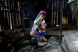 A Padaung woman with brass rings around her neck boils water at her home in Panpet Village, Demoso Township, Kayah State, Myanmar, April 11, 2016. The brass rings are first applied when the Padaung girls are about eight years old and as the girl grows older, longer coils are added up to 24 or 25 rings. EXPA Pictures © 2016, PhotoCredit: EXPA/ Photoshot/ U Aung<br /> <br /> *****ATTENTION - for AUT, SLO, CRO, SRB, BIH, MAZ, SUI only*****