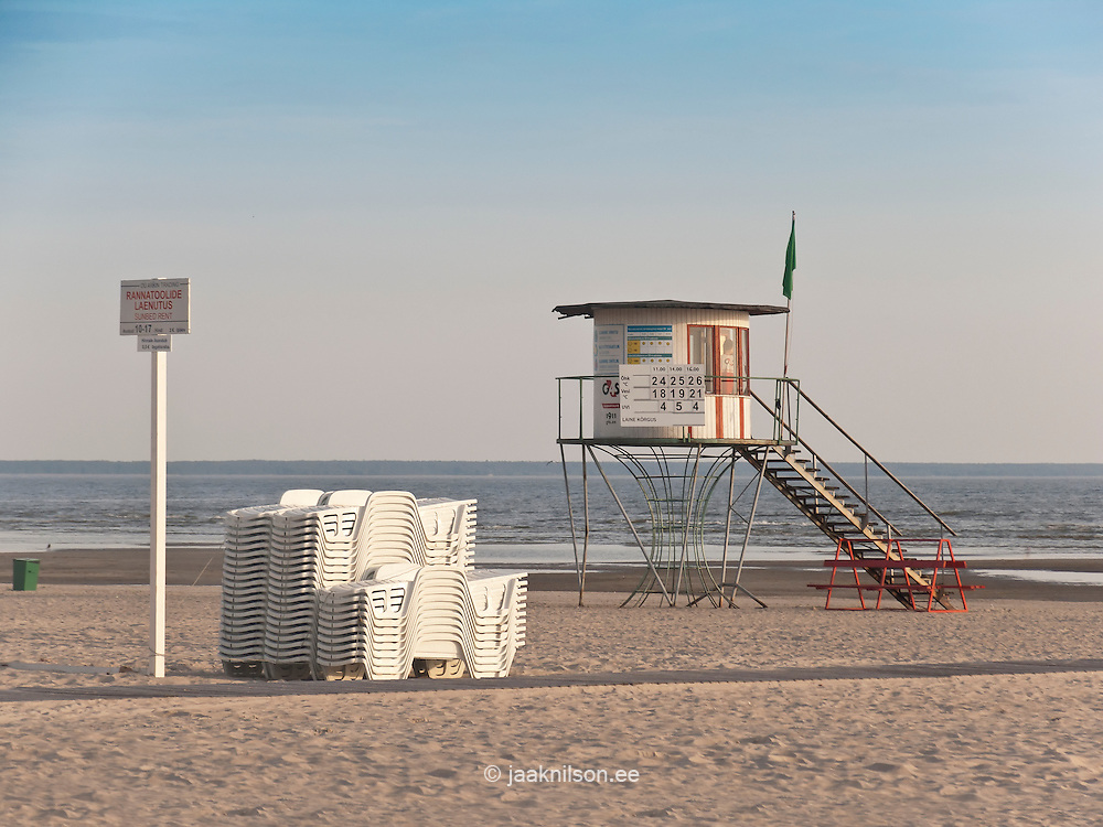 lifeguard tower at the empty beach by sea