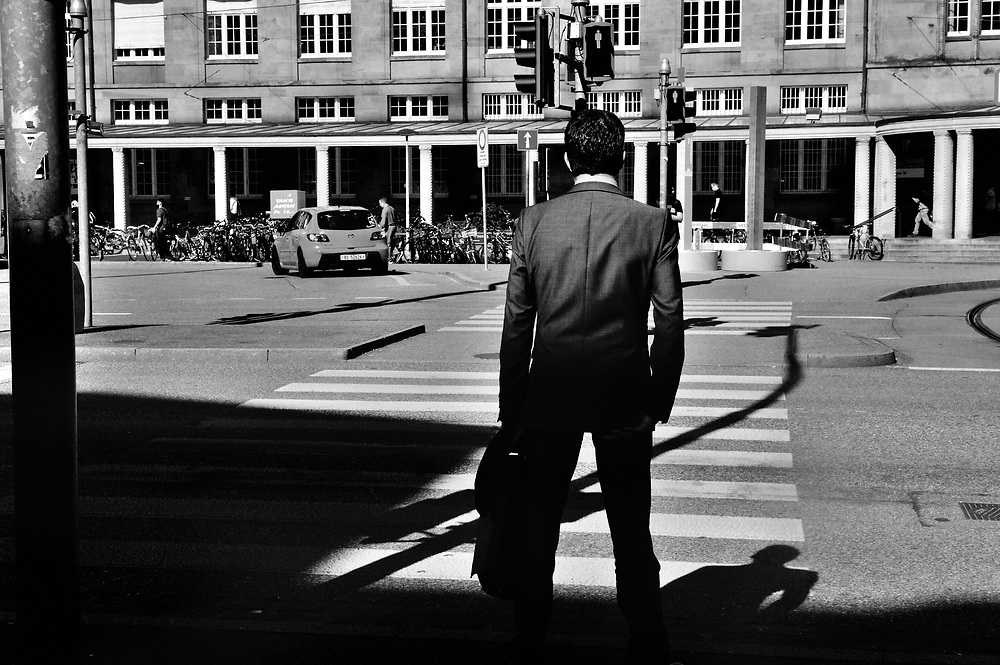 Man in a suit going to Basel's German railway station, after leaving Agrochemical company Syngenta, which is now owed by ChemChina.<br /> <br /> Basel, straddling the Rhine, and bordering both Germany and France, is a global centre for the pharmaceutical  industry &ndash; &lsquo;big pharma&rsquo;, with hundreds of biotech and &lsquo;life sciences&rsquo; companies ranging from start-ups to two of the top five global companies: Novatis and Hoffmann La Roche.<br /> <br /> The industry provides roughly 40% of total Swiss exports. The chemical and pharmaceutical industry currently employs around 65,000 people in Switzerland and over 355,000 internationally.