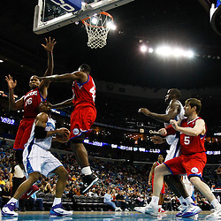 January 3, 2011; New Orleans, LA, USA; New Orleans Hornets power forward David West (30) is fouled by Philadelphia 76ers power forward Elton Brand (42) during the third quarter at the New Orleans Arena. The Hornets defeated the 76ers 84-77.  Mandatory Credit: Derick E. Hingle