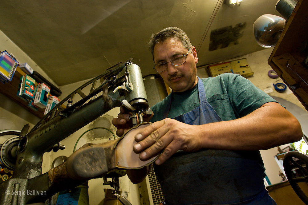 Ron Jacobs plies his time-honored skills while repairing boots and shoes in his shop in Santa Fe, New Mexico.