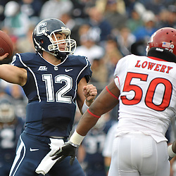 Oct 31, 2009; East Hartford, CT, USA; Connecticut quarterback Cody Endres (12) throws the ball under pressure from Rutgers linebacker Antonio Lowery (50) during first half Big East NCAA football action between Rutgers and Connecticut at Rentschler Field.
