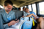 05/15/2013 - Eau Claire, Wis. - Rebecca DiBiase, A13, takes a break from her MCAT studies to share a laugh with teammate Steph Tercero, A15, during the ride to Eau Clair, Wisconsin for the Division III College World Series on Wednesday, May 15, 2013.  (Alonso Nichols/Tufts University)