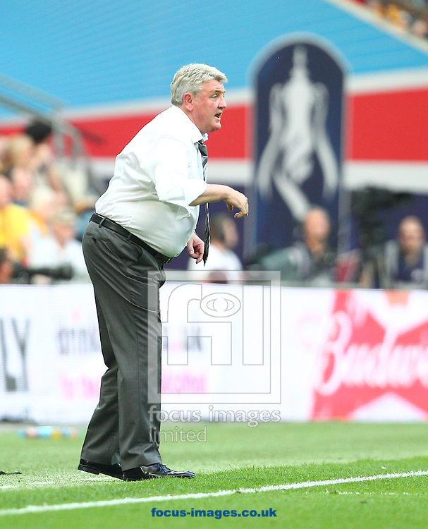 Steve Bruce, Manager of Hull City during the The FA Cup Final match at Wembley Stadium, London<br /> Picture by Paul Terry/Focus Images Ltd +44 7545 642257<br /> 17/05/2014