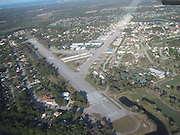 Spruce Creek where everybody Owns An Airplane<br /> <br /> Aside from an occasional Boeing, Spruce Creek's aircrafts consist of a stunning collection of Cessnas and Pipers, a P-51 Mustang, several L-39 Albatros, an Eclipse 500, a French Fouga Magister and even one Russian MiG-15 fighter jet. In addition to all the airplanes and golf cars, you'll see Lamborghinis, Corvettes, motorcycles of every description and even a Porsche GT2.<br /> <br /> The people of Spruce Creek live in a tightly knit community. Most of them are professional pilots and they talk in aviation jargon. Others are doctors, lawyers and land speculators, but all of them are, without exception, nuts about aviation. Every Saturday morning, some of them would gather beside the runway, take off in groups of three and fly to one of the local airports for breakfast – a tradition they call the Saturday Morning Gaggle.<br /> <br /> But Spruce Creek isn't the only residential airpark in the country. The concept first developed after World War II, a time period when the United States had an incredible surplus of both airfields and pilots, created by the war, whose population had ballooned from fewer than 34,000 in 1939 to more than 400,000 by 1946. In order to put countless deactivated military strips across the nation to good use and to accommodate the burgeoning pilot population, the Civil Aeronautics Administration proposed the construction of 6,000 residential airparks throughout the country. While that number was never fulfilled, the initial proposal generated enough momentum to pave the way for decades' worth of interest and investment in what has become a large and active network of fly-in communities.<br /> <br /> Today, there are more than 600 fly-in communities in the United States, with the heaviest concentration in Arizona, Colorado, Florida, Texas and Washington. Spruce Creek is the largest fly-in community. The aviation lifestyle has even spread internationally to Canada, South Africa and Costa 