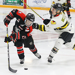 """TRENTON, ON  - MAY 5,  2017: Canadian Junior Hockey League, Central Canadian Jr. """"A"""" Championship. The Dudley Hewitt Cup Game 7 between Georgetown Raiders and the Powassan Voodoos.   Jack Jacome #23 of the Georgetown Raiders skates past  Cameron Moore #4 of the Powassan Voodoos during the second period<br /> (Photo by Alex D'Addese / OJHL Images)"""
