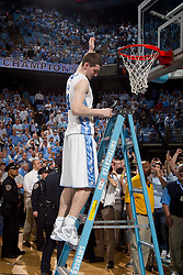 CHAPEL HILL, NC - MARCH 05: Tyler Zeller #44 of the North Carolina Tar Heels cuts down the net after defeating the Duke Blue Devils and winning the regular season ACC championship on March 05, 2011 at the Dean E. Smith Center in Chapel Hill, North Carolina. North Carolina won 67-81. (Photo by Peyton Williams/UNC/Getty Images) *** Local Caption *** Tyler Zeller