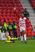 Shaun Cummings of Doncaster Rovers (29) and Andy Dales of Scunthorpe United (12) appeal for a throw in during the EFL Sky Bet League 1 match between Doncaster Rovers and Scunthorpe United at the Keepmoat Stadium, Doncaster, England on 15 December 2018.