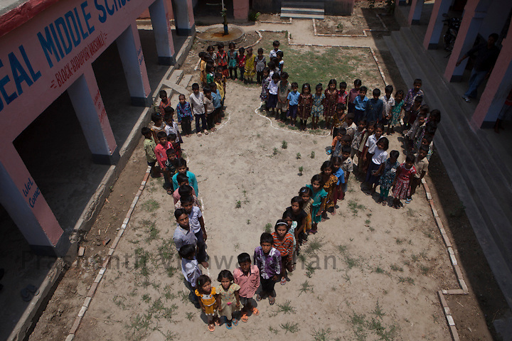 Upper Middle School: Maniyarpur Panchayat-Kaithwalia, Block- Biddupur  Bihar, India, 16 May 2013.Children stand in the formation of the India map at the quadrangle of government upper middle school Maniyarpur, May 16, 2013.  As part of the School Sanitation and Hygiene Education (SSHE) programme being implemented in partnership with Department of Education, Government of Bihar, UNICEF Bihar is supporting  the construction of  inclusive, child-friendly water and sanitation facilities in schools, with a focus on  addressing needs of 'differently abled children'.  UNICEF India/2013/Prashanth Vishwanathan
