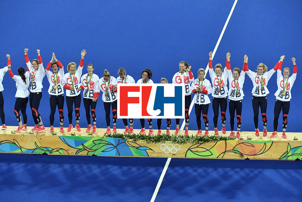 Britain's gold medallists celebrate on the podium during the women's field hockey medals ceremony of the Rio 2016 Olympics Games at the Olympic Hockey Centre in Rio de Janeiro on August 19, 2016. / AFP / Pascal GUYOT        (Photo credit should read PASCAL GUYOT/AFP/Getty Images)