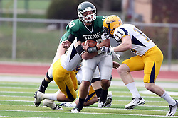 12 November 2011:  Erik Westerberg wraps up Rob Gallik while getting assistance from Cole Urban on a quarterback option play during an NCAA division 3 football game between the Augustana Vikings and the Illinois Wesleyan Titans in Tucci Stadium on Wilder Field, Bloomington IL