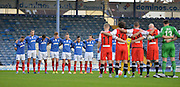 Portsmouth and Macclesfield player with a minute silence  during the The FA Cup match between Portsmouth and Macclesfield Town at Fratton Park, Portsmouth, England on 7 November 2015. Photo by Adam Rivers.