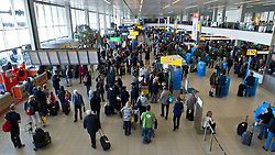 Travelers move through departure hall 2 at Schiphol Airport in Amsterdam, the Netherlands, on Tuesday, April 20, 2010. (Photo © Jock Fistick)