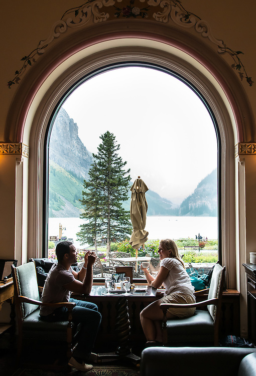 Beauty indoors and outdoors. Chateau lake Louise lobby cafe .  Banff National Park, Alberta, Canada.