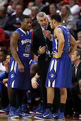 31 December 2014:  Tre' Bennett and Brenton Scott speak to Greg Lansing during a free throw during an NCAA Division 1 Missouri Valley Conference (MVC) men's basketball game between the Indiana State Sycamores beat the Illinois State Redbirds 63-61 at Redbird Arena in Normal Illinois
