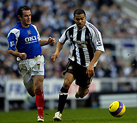 Photo: Jed Wee.<br /> Newcastle United v Portsmouth. The Barclays Premiership. 26/11/2006.<br /> <br /> Newcastle's Kieron Dyer (R) looked in good form as he takes on Portsmouth's David Thompson.
