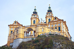 Melk Abbey or Stift Melk[1] is an Austrian Benedictine abbey, and one of the world's most famous monastic sites. It is located above the town of Melk on a rocky outcrop overlooking the river Danube in Lower Austria, adjoining the Wachau valley.<br /> <br /> The abbey was founded in 1089 when Leopold II, Margrave of Austria gave one of his castles to Benedictine monks from Lambach Abbey. A school was founded in the 12th century, and the monastic library soon became renowned for its extensive manuscript collection. The monastery's scriptorium was also a major site for the production of manuscripts. In the 15th century the abbey became the centre of the Melk Reform movement which reinvigorated the monastic life of Austria and Southern Germany.<br /> <br /> Today's impressive Baroque abbey was built between 1702 and 1736 to designs by Jakob Prandtauer. Particularly noteworthy is the abbey church with frescos by Johann Michael Rottmayr and the impressive library with countless medieval manuscripts, including a famed collection of musical manuscripts and frescos by Paul Troger.