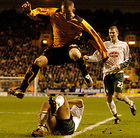 Photo: Glyn Thomas.<br />Wolverhampton Wanderers v Plymouth Argyle. Coca Cola Championship. 31/12/2005.<br />Wolves' Kenny Miller leaps over a challenge from Anthony Barness.