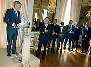 """Michel Drucker and Deputy Prime Minister Didier Reynders with (LtoR)François Pirette, Salvatore Adamo, Eddy Merckx, Jacky Ickx, Eric-Emmanuel Schmitt at the ceremony who Michel Drucker was awarded at  the title of Commander of the Order of the Crowne at the Palace Egmont"""" at Brussels, 2014 in Brussels, Belgium."""