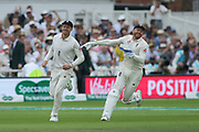 Jos Butler of England and Jonny Bairstow of England celebrate  the wicket of Shikhar Dhawan of India during the 3rd International Test Match 2018 match between England and India at Trent Bridge, West Bridgford, United Kingdon on 18 August 2018.