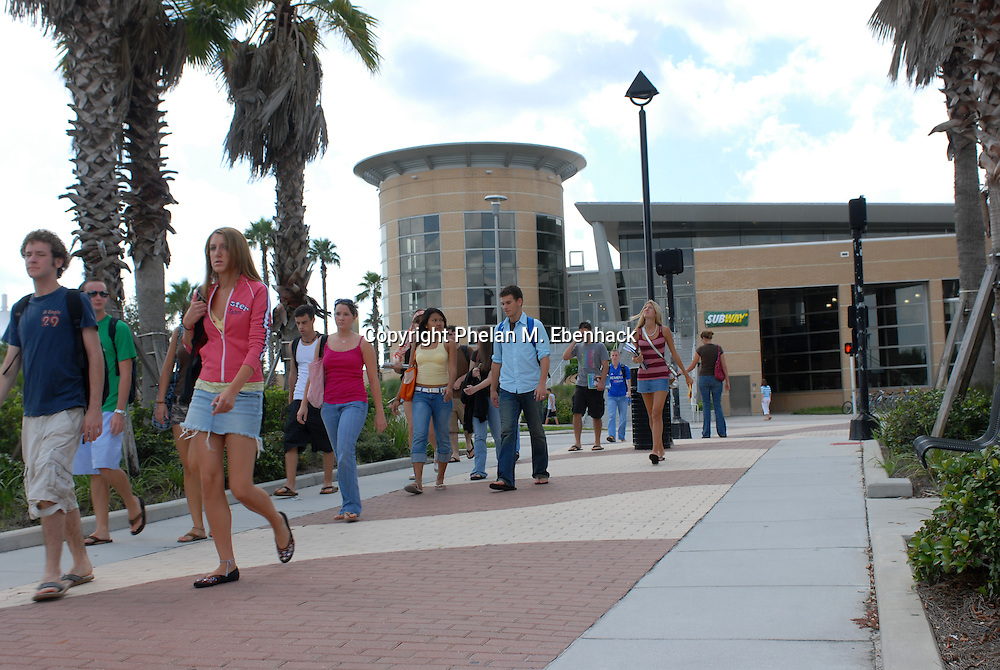 Students walk to class at the University of Central Florida in Orlando, Florida.