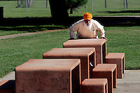 LODI, CA - JUNE 10:  A man does some morning exercises at a park on June 10, 2005 in Lodi California. Lodi, the sleepy Northern California town has been hit with controversy after 5 people were arrested by the FBI in connection with immigration and possible terrorist activities.  Photograph by David Paul Morris