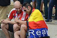 General view of the exterior of the stadium showing an Atletico Madrid fan (left) and a Real Madrid fan sharing a joke pictured ahead of the UEFA Champions League Final at Estádio da Luz, Lisbon<br /> Picture by Ian Wadkins/Focus Images Ltd +44 7877 568959<br /> 24/05/2014