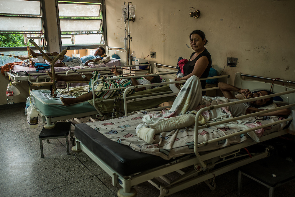 PUERTO LA CRUZ, VENEZUELA - APRIL 15, 2016: Creative doctors rigged homemade devices using recycled soda bottles and water jugs as weights to treat patients with broken legs. Hospital Universitario Dr. Luís Razetti is one of the worst state-run, public hospitals in Venezuela.  Doctors compare it to working in a war zone - they regularly have to turn patients away, because they don't have the majority of medicines  or medical equipment and supplies needed to give them medical attention.  When they do accept patients, they have to work with extremely limited resources, because they don't have the supplies they need for things like X-Rays,  and many exams nd operations.  The hospital's infrastructure is crumbling, and staff don't have all the cleaning supplies required to keep the hospital sanitary. The hospital also suffers from weekly shortages of running water and electricity.  In April, several babies died when a power outage turned off the incubators, and the hospital's generator failed to work because of lack of maintenance.  The same month, authorities found over 100 pieces of medical equipment, stolen from the hospital in the home of the assistant to the hospital's director.  Despite having the largest oil reserves in the world, falling oil prices and wide-spread government corruption have pushed Venezuela into an economic crisis, with the highest inflation in the world and chronic shortages of food and medical supplies.  PHOTO: Meridith Kohut