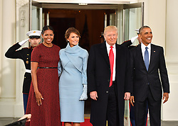 January 20, 2017 - Washington, District of Columbia, U.S. - President Barack Obama (R) and Michelle Obama (L) pose with President-elect Donald Trump and wife Melania at the White House before the inauguration on January 20, 2017 in Washington, D.C.  Trump becomes the 45th President of the United States. (Credit Image: © Kevin Dietsch/CNP via ZUMA Wire)