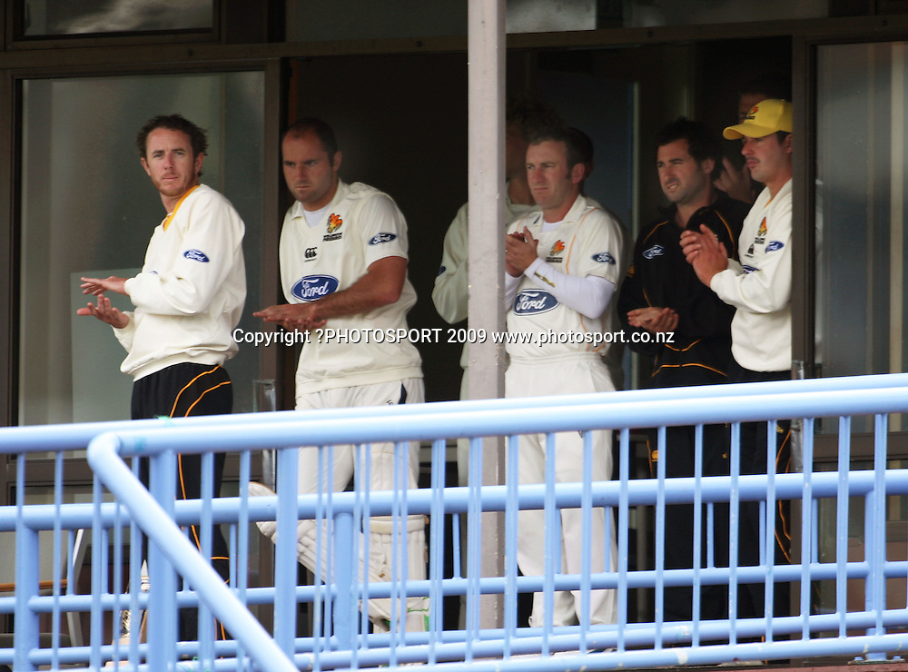 Wellington players clap Josh Brodie and Cameron Merchant off at afternoon tea.<br /> Plunket Shield cricket - Wellington Firebirds v Canterbury Wizards at Allied Nationwide Finance Basin Reserve, Wellington. Tuesday, 10 November 2009. Photo: Dave Lintott/PHOTOSPORT