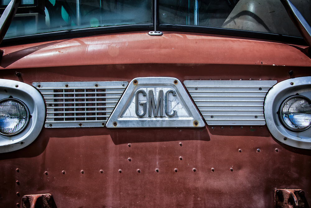 American Truck from the 1960s. Close up of bonnet or hood with gmc grill and headlights