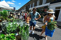 © Licensed to London News Pictures. 05/07/2020. LONDON, UK.  Plant lovers visit Columbia Road Flower Market in East London on the its reopening after certain coronavirus pandemic lockdown restrictions were relaxed by the UK government.  Photo credit: Stephen Chung/LNP