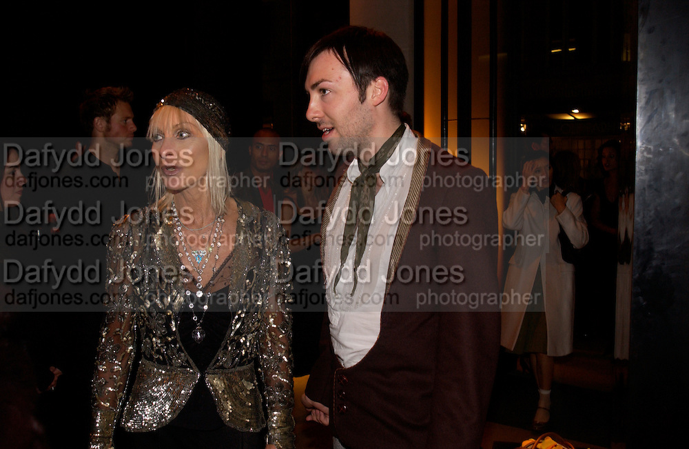 Virginia Bates and james Long, Donna Karan Party to celebrate 20 Years  as a designer.  Showroom in New Bond St. 21 September 2004. DoSUPPLIED FOR ONE-TIME USE ONLY-DO NOT ARCHIVE. © Copyright Photograph by Dafydd Jones 66 Stockwell Park Rd. London SW9 0DA Tel 020 7733 0108 www.dafjones.com