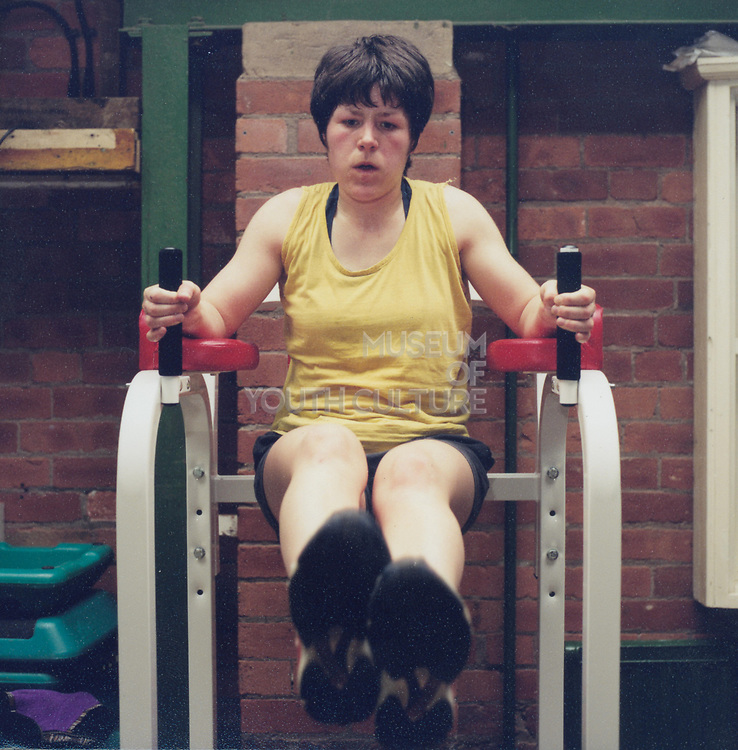A woman working out on a piece of gym equipment