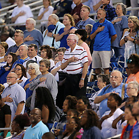 Tupelo fans stand during the National Anthem before the start of the Tupelo vs Columbus game on Friday night.